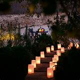garden steps with paper bag lanterns and stone wall